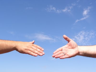 hand reaching out to hand